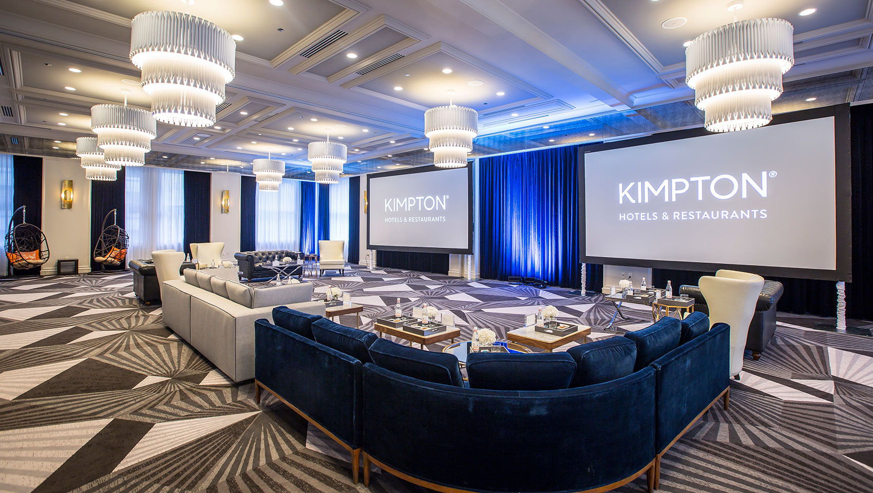 Round table setup in the ballroom of Kimpton Gray Hotel