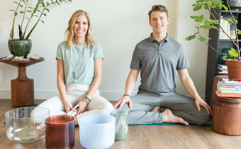 woman and man sitting for in a yoga pose
